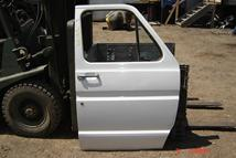 Pictured above is a 73 - 91 Ford Econoline Van Right side door