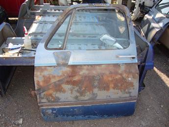 1973 1974 1975 1976 1977 1978 1979 1980 1981 1982 1983 1984 1985 1986 1987 Chevrolet GMC complete power door with glass.  Some surface rust in the middle front center.  Front edge is bent over a little bit, paint is peeling.  Reference inventory #11191 when inquiring.