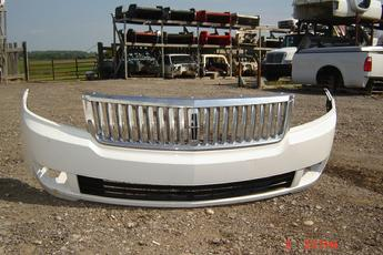 2006 2007 2008 Ford Lincoln MKS Chrome Gille & Lower Bumper Cover.  Excellent condition.