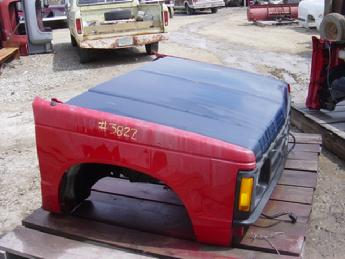 1982 1983 1984 1985 1986 1987 1988 1989 1990 1991 1992 1993 Chevrolet S10 front clip assembly.  Very good condition, has a black grille. Red fenders, blue hood.,